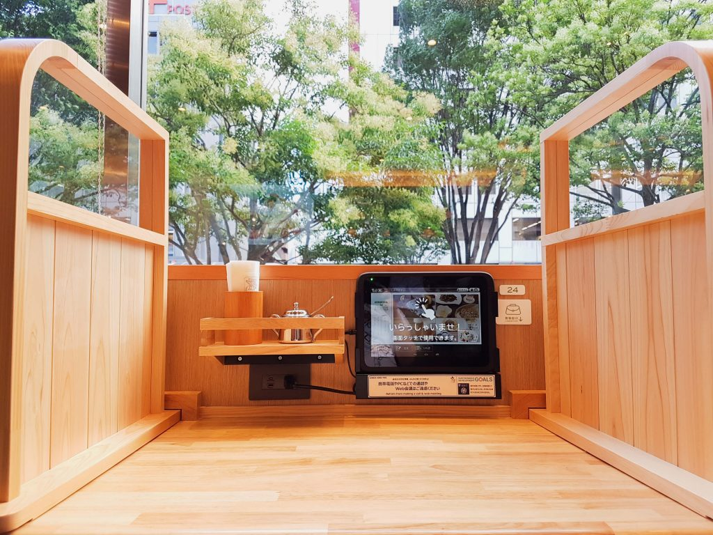 Well-partitioned window seat for solo customers at Komeda Is